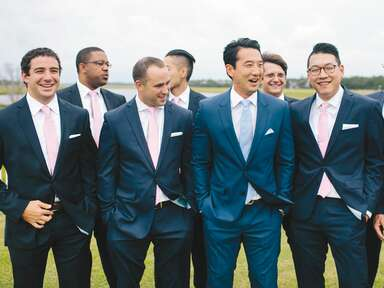 Groom and groomsmen in navy tuxedos