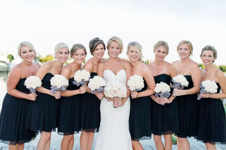 The bridesmaids wore short, black, strapless chiffon J.Crew dresses. They sported gold shoes with rhinestone and pearl details to match the bride, and were given beautiful Kate Spade earrings to match the ensemble.