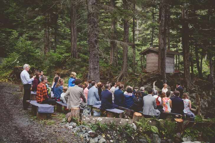 After trekking to the ceremony site in Sitka, Alaska, guests sat on fabric-covered log benches.