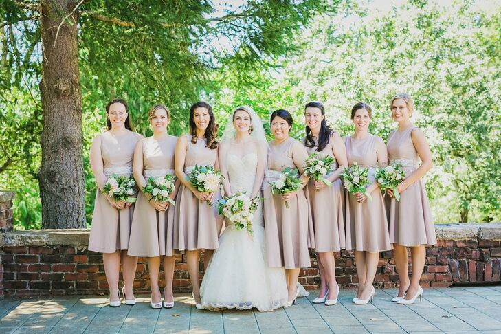 "These custom khaki dresses with an ivory lace waistband were perfect for the summer and the rustic, refined-yet-relaxed event. ""We were looking for a classic Audrey Hepburn style and based the pattern off a J.Crew summer dress that I own,"" Emily says. Sporting crisp white pumps, each bridesmaid had her hair styled in soft updos and curls, again reflecting the relaxed nature of the day."