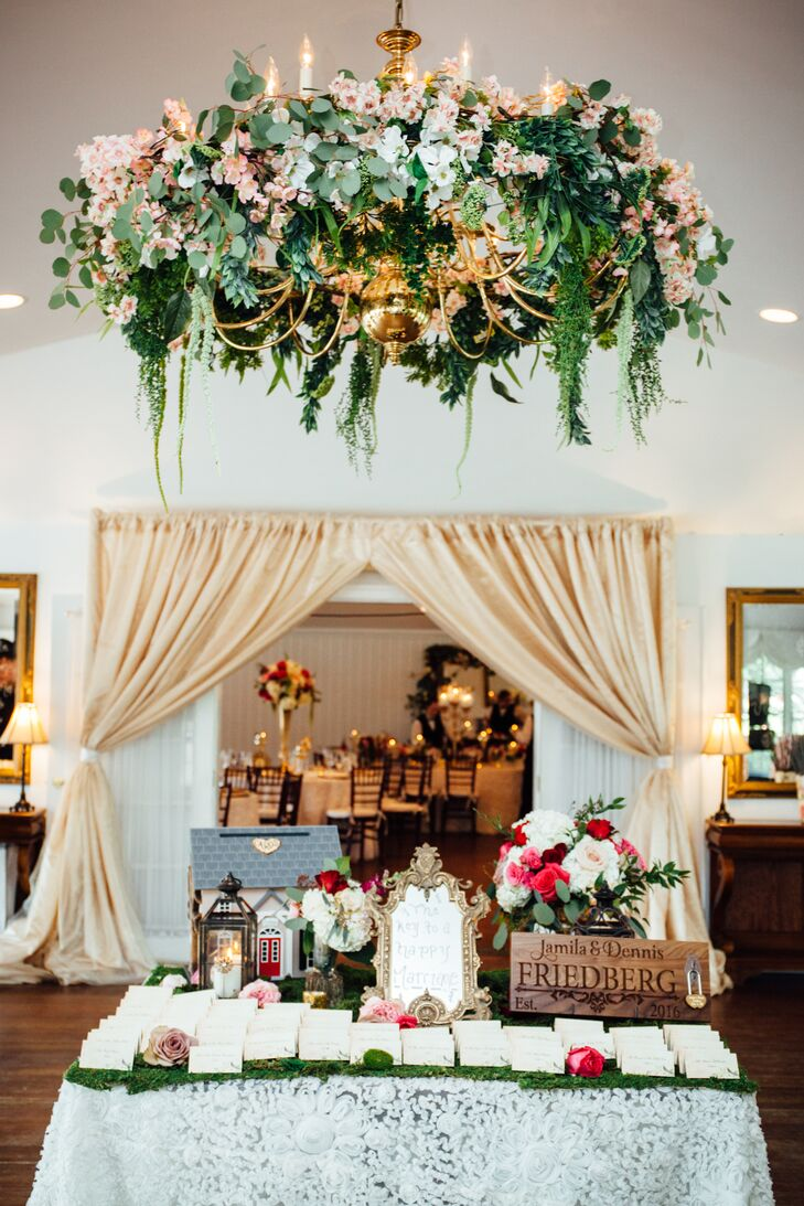 Jamila and Dennis left no detail unnoticed. Bringing the beauty of the outdoors in, the couple decorated Antrim 1844's chandeliers with garlands of eucalyptus, fresh pink flowers and wispy greenery cascaded from the gilded chandeliers to achieve a whimsical, gardenlike vibe.