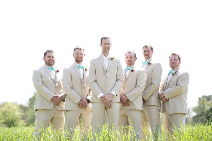 Matching Groomsmen in Tan Suits and Blue Bow Ties