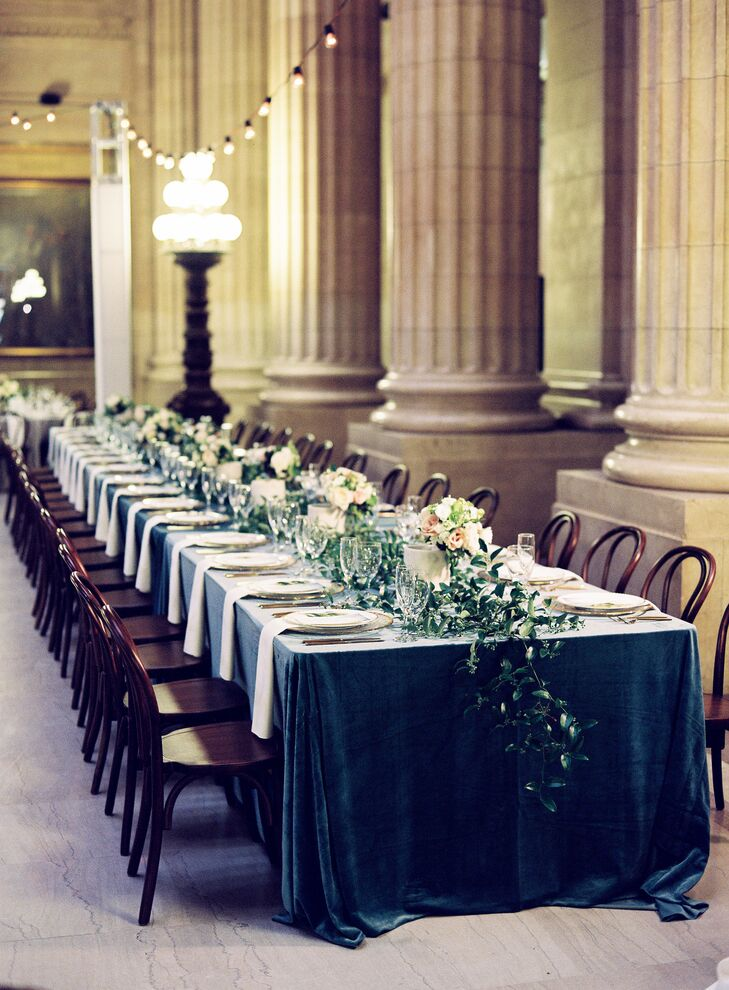 Long Dining Table with Blue Tablecloth and Greenery Runner