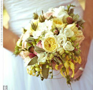 A departure from the eye-popping flowers that filled the rest of the day, the bride carried a more subdued mix of roses, freesia and scabiosa with olive branches for texture.