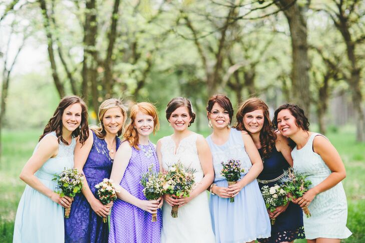 "Rachel had each of her six bridesmaids choose their own dress. ""My only requirement was for it to be a shade of blue,"" she recalls. ""I have to say, I have some classy friends whom I fully trusted to pick the perfect blue attire."""