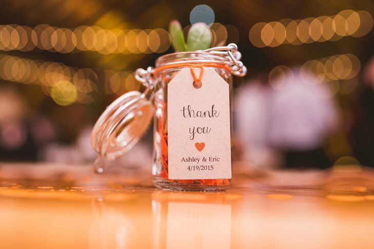 Ashley and Eric put their own spin on a rustic wedding favor. Each guest took home a different mini succulent planted in a wine cork and set inside a mini mason jar.