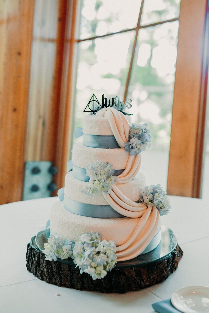 Wedding Cake With Blue Ribbon Fondant Draping And Harry Potter Topper