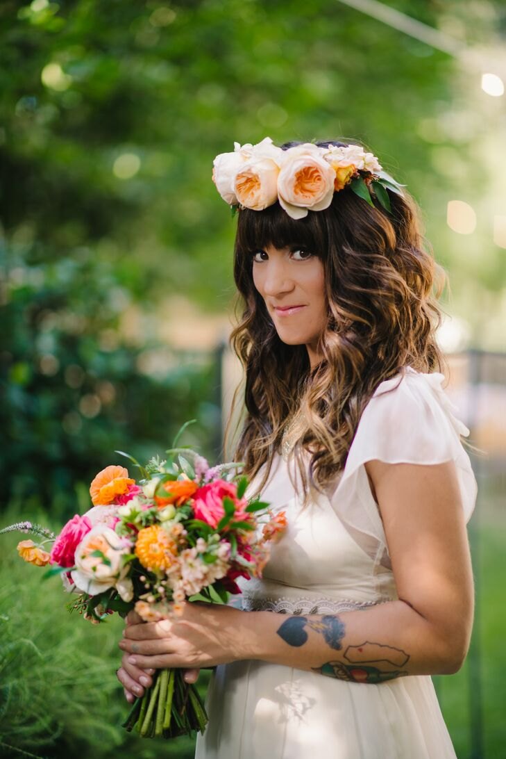 Liz's bouquet consisted of bright pink, orange and plush garden roses, dahlias, mums and wildflowers. She also wore a crown of full blush garden roses.