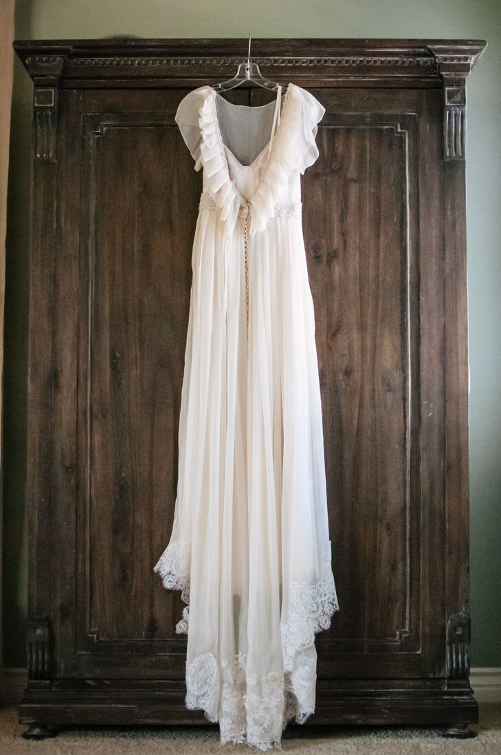 """The bride's wedding dress is very special to her, as she was able to incorporate both her grandmother's and her mother's wedding dresses. """"Since my grandmother and my dad are no longer with us, it made me feel as though I had a piece of them there with me that day,"""" says Liz."""