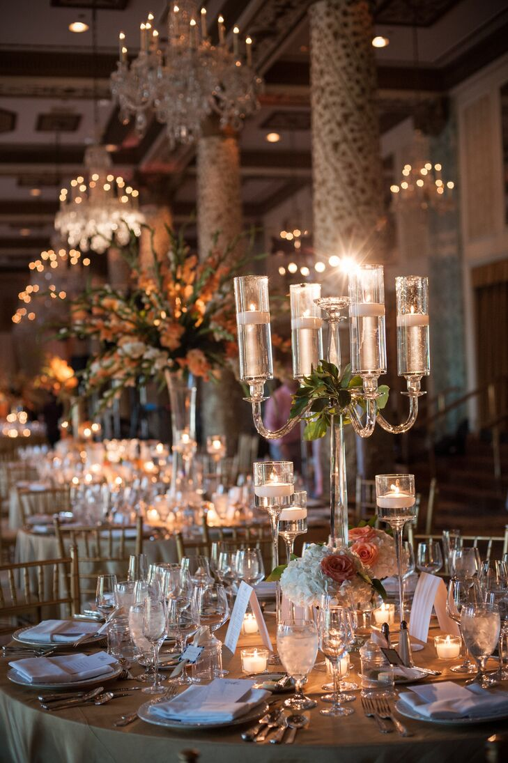 Centerpieces at the reception included crystal candelabras with floating candles that were wreathed by white hydrangeas and peach roses. These candelabras were also surrounded by votive candles that echoed the candlelight.