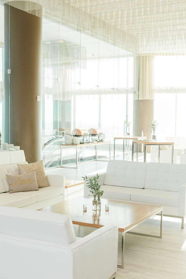 White lounge furniture in modern loft venue