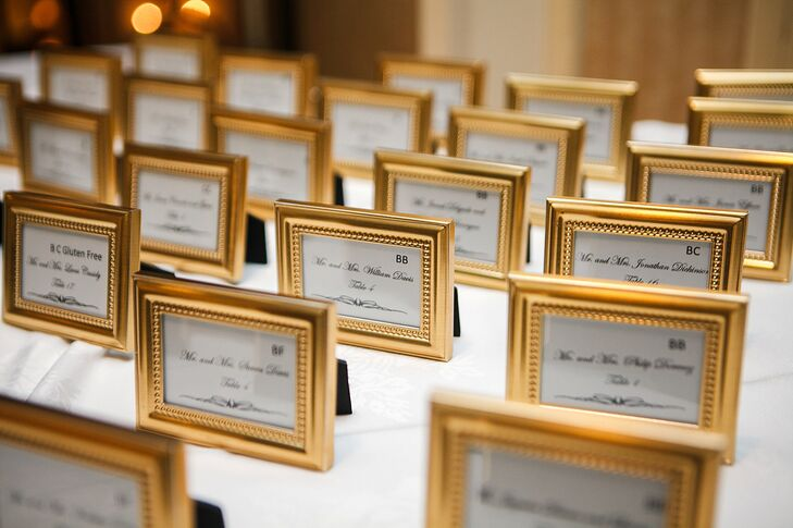 Aside from customized coasters, guests were also gifted with simple fold frames from Favor Warehouse that doubled as escort card displays.