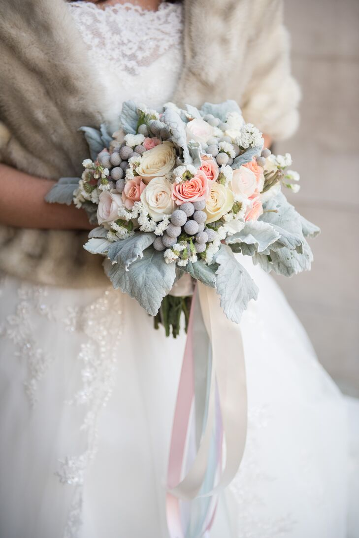 Kelly's bouquet, the most colorful and vibrant of the bridal party, featured pink, cream, latte and peach roses, greens, brunia berries, dusty miller, and white statice for texture. The icy look of the dusty miller brought wintry romance to the arrangement.