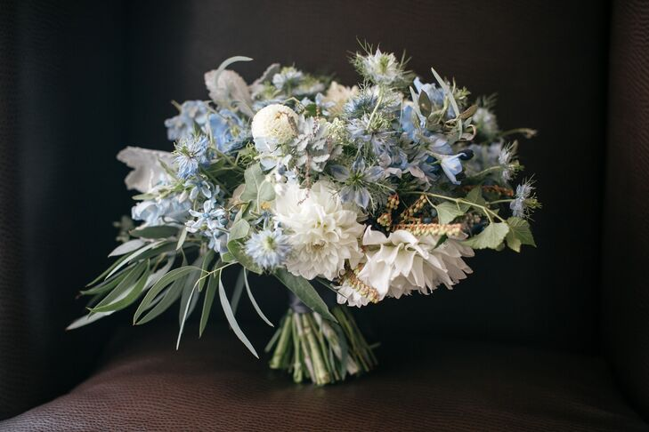 Amy Young of Leaves of Grass Floral Design put her floral design skills to work, creating eye-catching arrangements with a distinct organic vibe. For Samantha's bouquet, she put together a beautiful mix of white dahlias, blue delphiniums, dusty miller, eucalyptus and more, which perfectly embodied the day's palette and feel.
