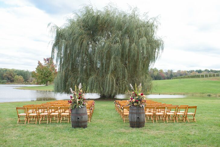 The fall ceremony was held under a willow tree by the pond at Trump Winery.