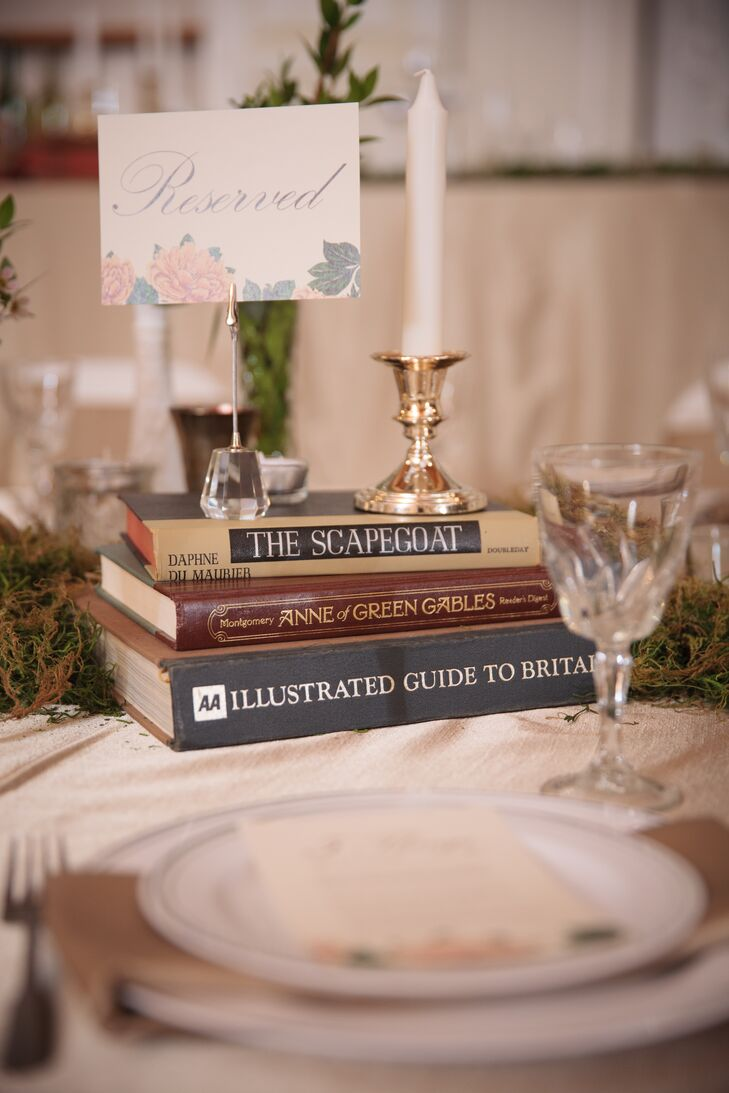Vintage stacked books were used in the creative, eclectic centerpiece arrangements.