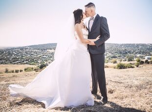 With natural foliage and breathtaking hillside views, it's hard to believe that this intimate, backyard wedd