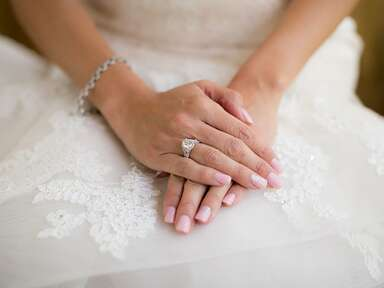 bride wearing engagement ring and bracelet on wedding day