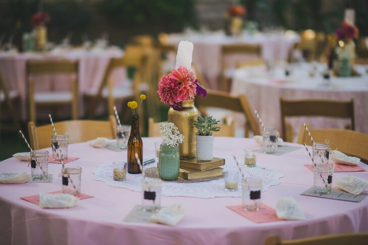 Desert sunset hues inspired the color palette. Floral arrangements of dahlias, billy balls and succulents in painted mason jars with gold centerpieces added bright pops of color to the dining tables.