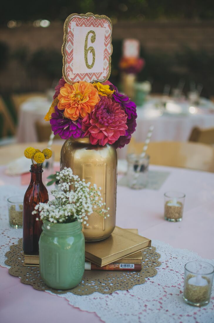 Liz and her family created all the centerpieces and decor, which included old books and painted mason jars for a vintage and bohemian ambiance.