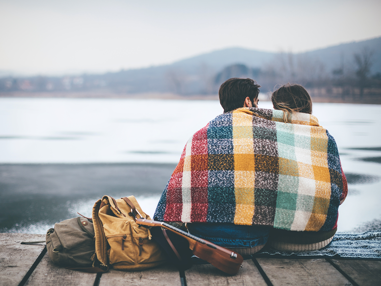 Couple under blanket