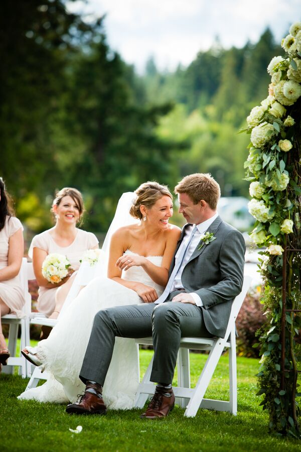 Michelle and Jeff shared a moment in the middle of the ceremony, where they sat next to each other and smiled. Jeff sported a light gray suit, paired with a light gray tie that all the groomsmen matched.