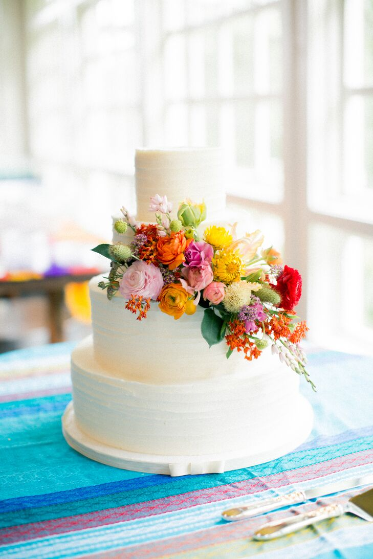 Combed Buttercream Cake with Colorful Cascading Flowers