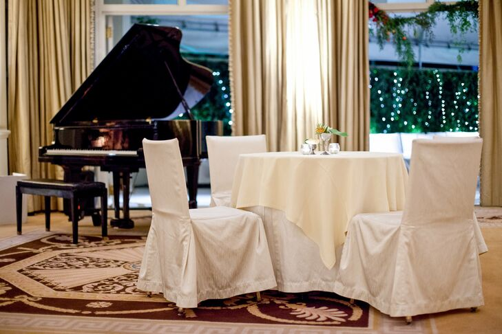 At the reception dinner, guests sat on linen-covered chairs and dined on ivory and white tablecloths.