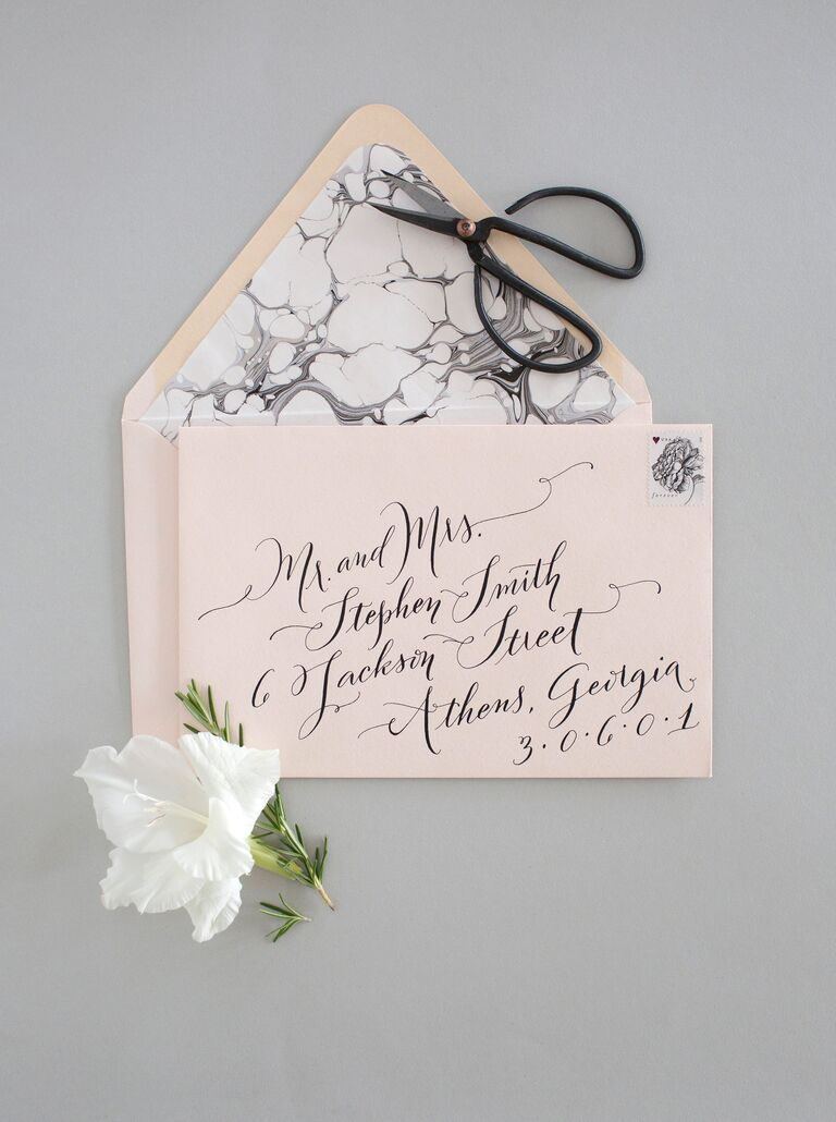 Light pink and gray wedding invitations with marble lining