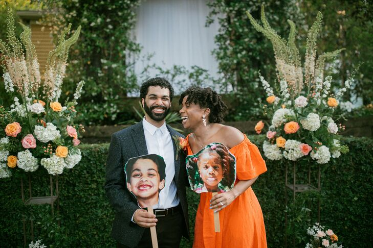 Couple with Childhood Pictures During Wedding in Atlanta, Georgia