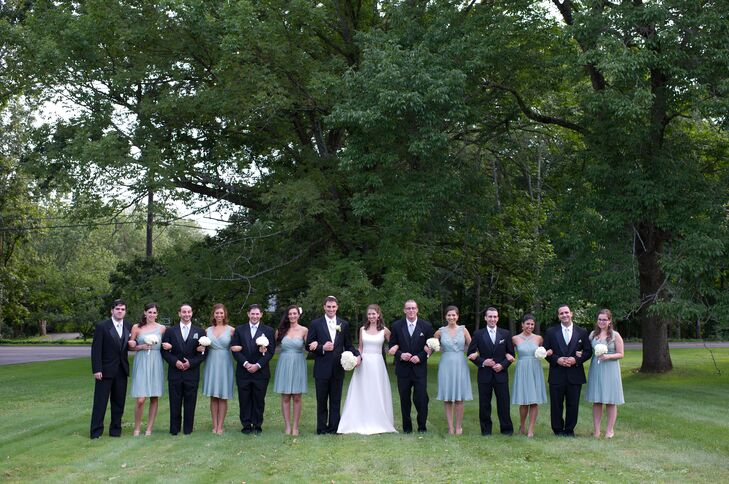 """""""The groomsmen wore suits from Jos. A. Bank, with ties -- purchased separately -- in the same color as the bridesmaid dresses,"""" Sarah says. """"The groom's vest and tie matched my bridal gown."""""""