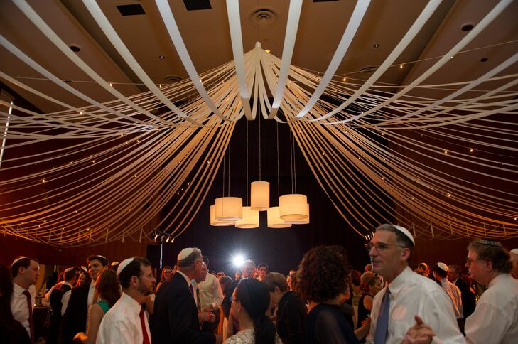 """""""We needed enough room to comfortable seat 230 people, and to allow space for a large dance floor, as well as a cocktail area. Our choice was perfect for us: large, meaningful, convenient to many of our guests and open to however we wanted to decorate,"""" Sarah says."""