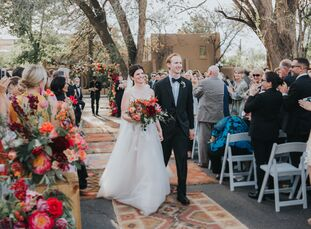With a color palette inspired by Southwest sunsets and nods to New Mexican culture, Clare Adams and Keith Levy planned a vibrant, bohemian affair with