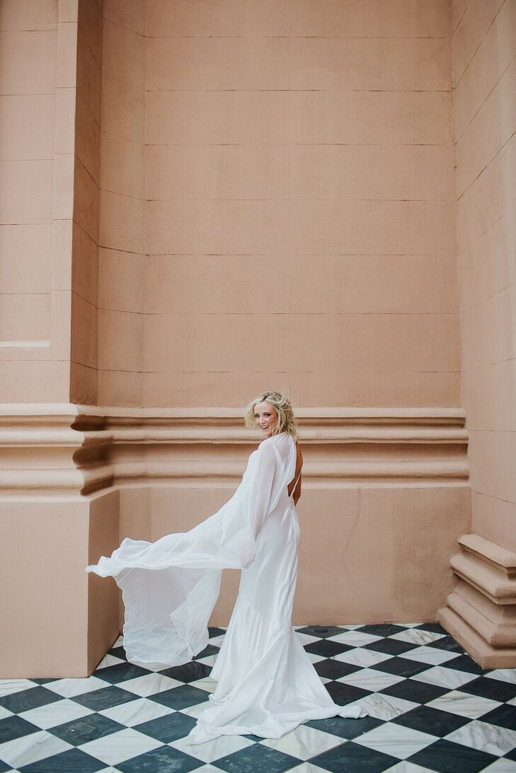 Modern, Whimsical Dress with Flowy Cape and Updo