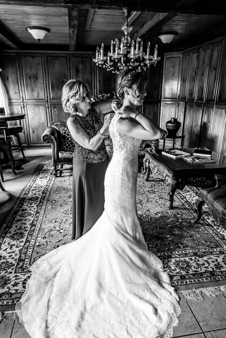 Kerry found her stunning dress at Bijou Bridal. She was immediately drawn to the open back with sheer lace creating an asymmetrical oval shape. The subtle beading on the bodice and timeless buttons down the back were the perfect touch.