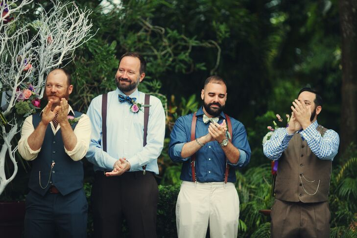 """With some input from the menswear pros at Martin Freeman, Annie and Owen decided all the groomsmen would wear a combination of light blue and brown. They also chose a casual English gentleman inspired-look. """"The men really got into it—it was awesome,"""" Annie says. They picked out every detail of their looks, from the vests and ties to the suspenders and shirt styles. Some even wore pocket watches to give it a true """"gentleman's touch."""""""