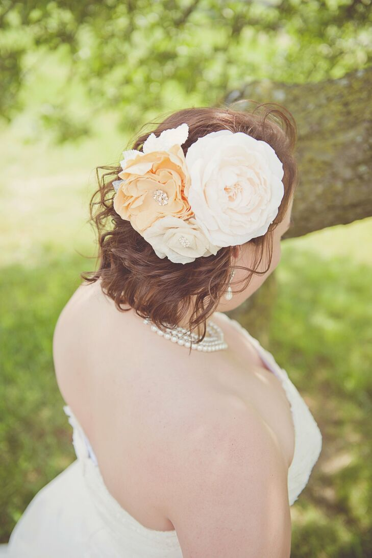The bride opted for a floral fascinator from Twigs & Honey in lieu of a veil.  The pearls she wore are vintage, passed down from her great-grandmother.