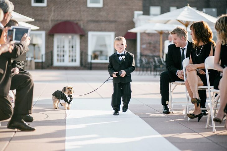The ring bearer, dressed in a smart black tuxedo, walked Ashley and Gabby's dog Spicy down the aisle.