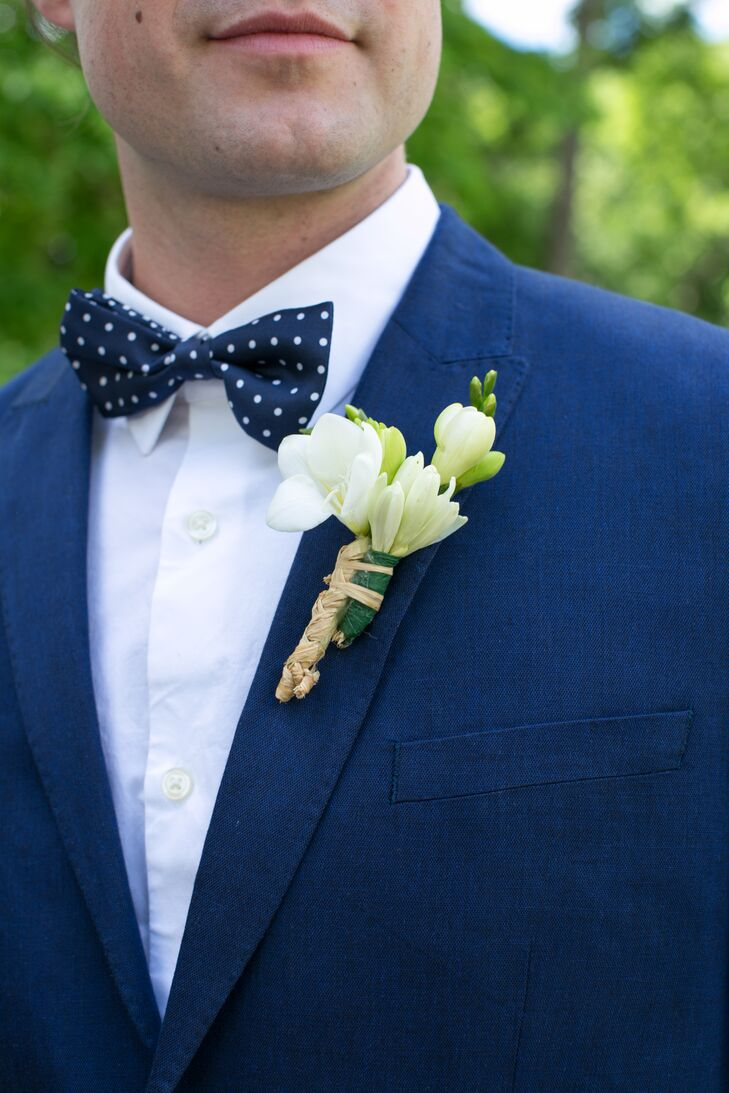 """""""The main flower was a tuberose,"""" Kate says. """"My last name is now Teuber. I chose this flower hence the name. Tuberoses smell amazing also."""" The groom wore a simple tuberose boutonniere."""