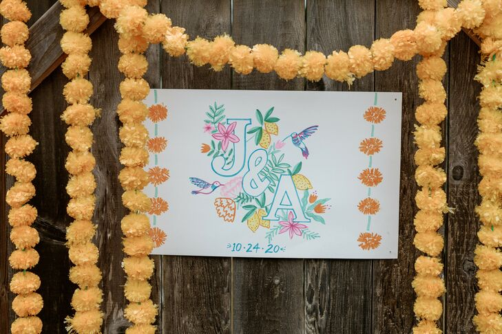 Monogram Sign Surrounded by Marigolds