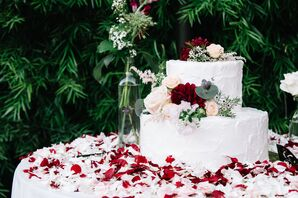 Two-Tier White Wedding Cake With Flowers and Greenery