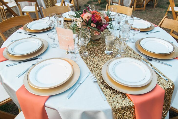 """We had a gold-sequined runner on each table to bring a lot of glitz and texture and gold charger plates to add even more pop,"" Jillian says. Gold vases filled with coral flowers topped each table."
