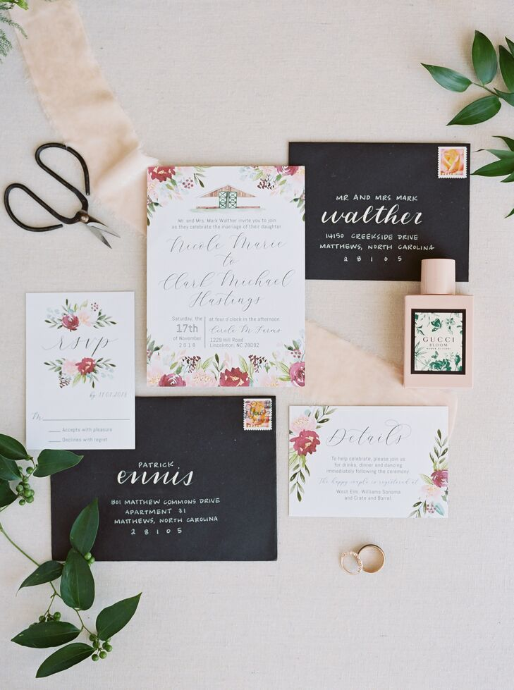 White Invitations with Flower Motif and Black Envelopes