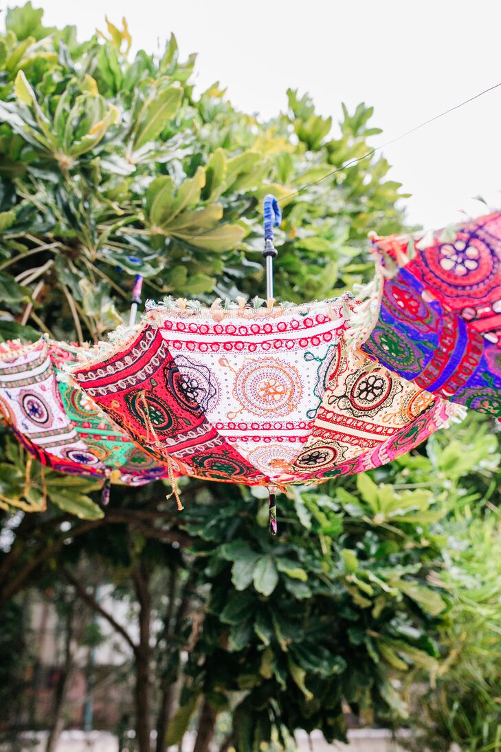 Colorful and Whimsical Hanging Umbrellas with Hindu Designs