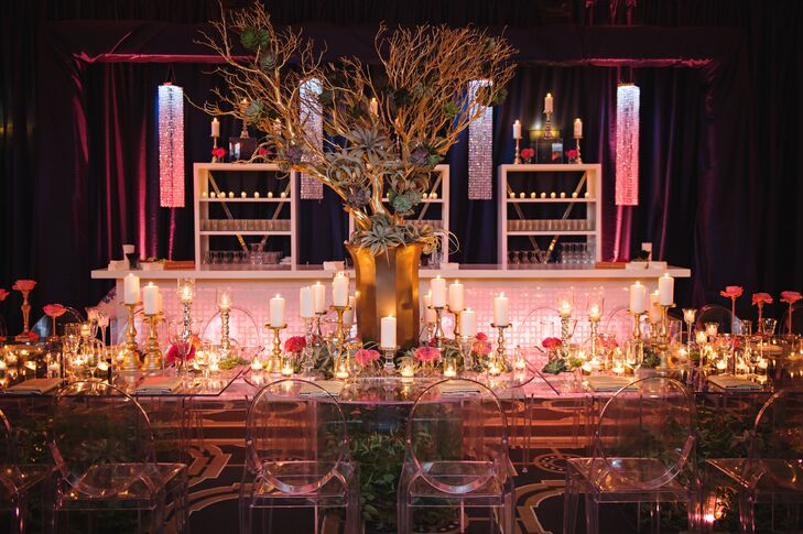 Modern Lucite tables overflowing with whimsical air plants, candles, flowers and gold details added to the ultra-luxe vibe at Kelly and Walt's reception.