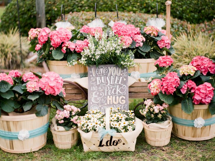 In front of the stable, a wagon was filled with baskets of flowers, which Kaitlin's mother decorated with strands of pearls and tulle and finished with a handwritten sign.