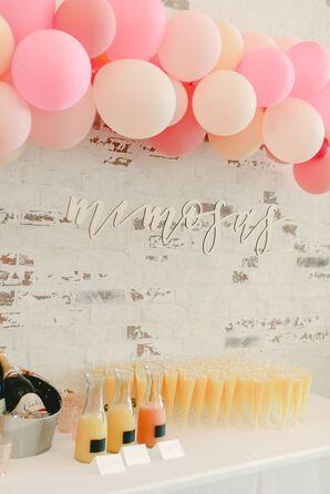 Mimosa Bar at Brunch Wedding with Pink Balloon Installation