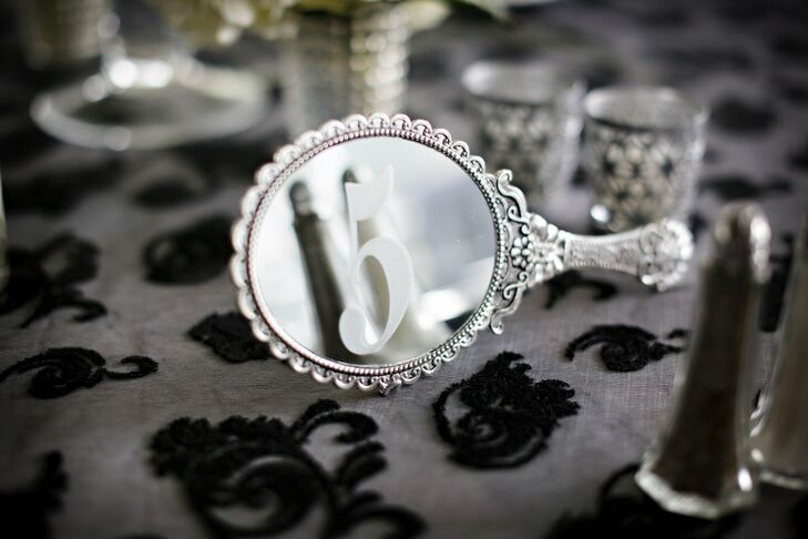 Tables were designated with elegant etched hand-held mirrors.
