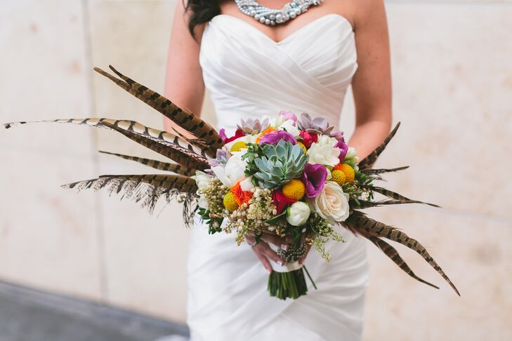 The busy bouquet made up of colorful roses, craspedia, succulents and feathers created an arrangement that Kaitlyn carried down the aisle. The vibrant shades definitely created a statement against her classic white wedding dress.