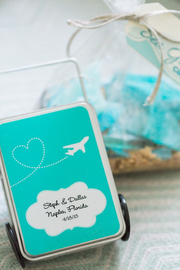 Instead of giving out favors at the wedding, Stephanie and Dallas gave their guests large welcome bags before the celebration. Each one reflected their professions at Southwest Airlines with suitcase-inspired tins of mints and peanuts. Their beach theme was also incorporated with blue sea glass candy.